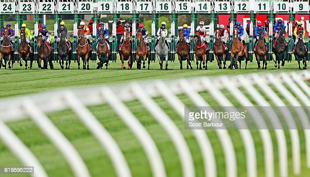 A general view as the horses break from the barriers at the start of Race 7 the Emirates Melbourne Cup on Melbourne Cup Day at Flemington Racecourse...
