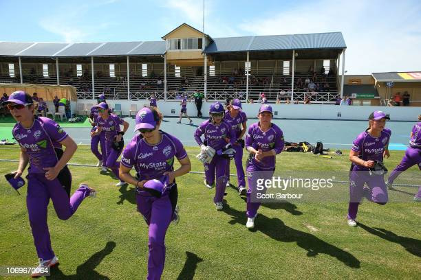 A general view as the Hurricanes run onto the field during the Women's Big Bash League match between the Hobart Hurricanes and the Melbourne Stars at...