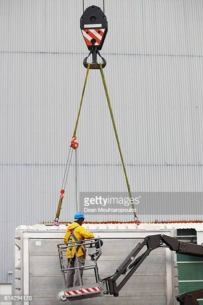 A general view as the ICARUS cryostat doors are removed moved by staff within The European Organization for Nuclear Research commonly know as CERN on...
