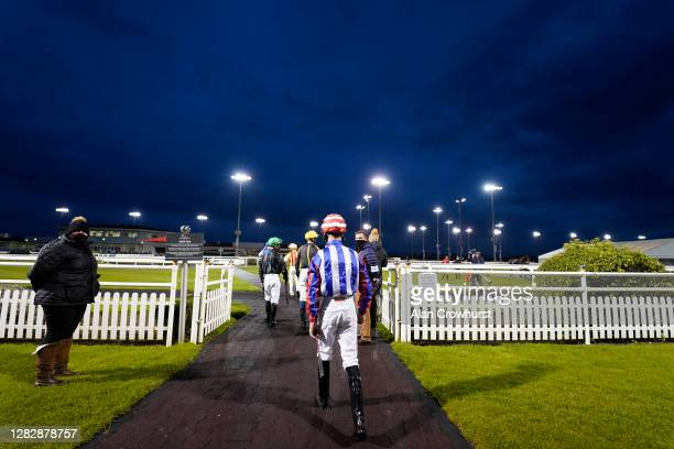 General view as the jockeys enter the parade ring at Chelmsford City Racecourse on October 29, 2020 in Chelmsford, England. Owners are allowed to...