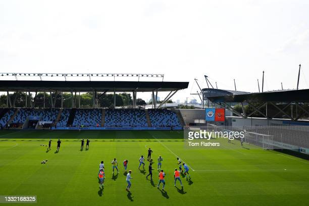 General view as the Manchester City team warm up ahead of the pre-season friendly match between Manchester City and Blackpool at Manchester City...