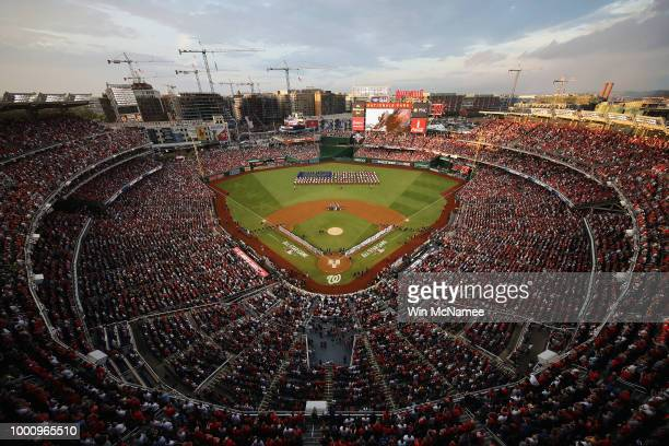 A general view as the national anthem is performed before the 89th MLB AllStar Game presented by Mastercard at Nationals Park on July 17 2018 in...
