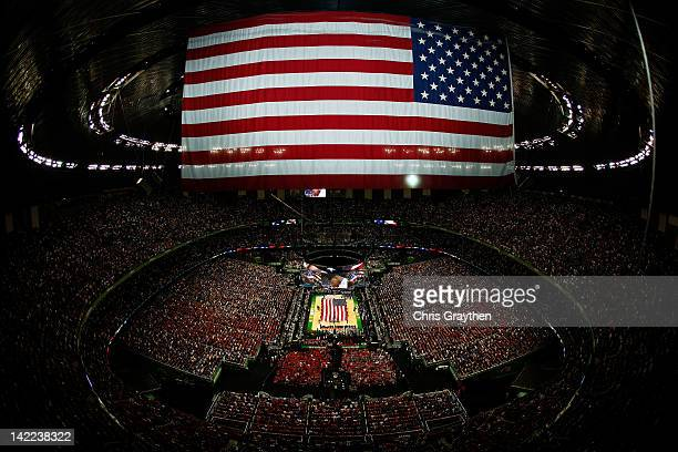 A general view as the national anthem is performed before the Louisville Cardinals take on the Kentucky Wildcats in the National Semifinal game of...