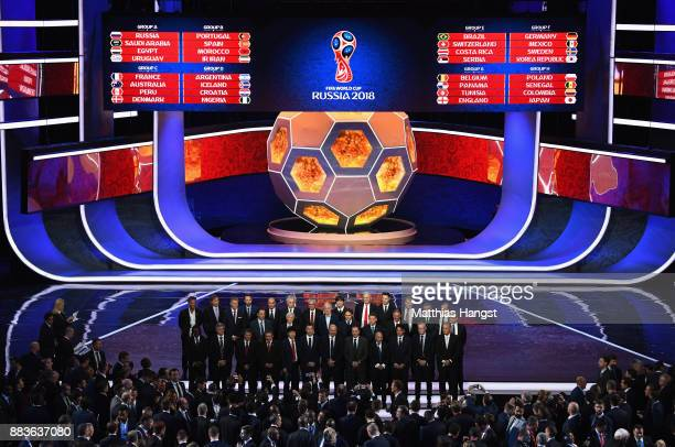 A general view as the national team managers pose for a photo on the stage after the Final Draw for the 2018 FIFA World Cup Russia at the State...