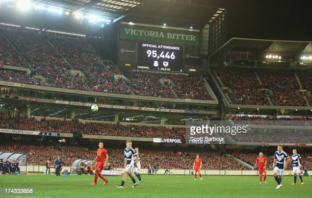 A general view as the scoreboard shows the official attendance during the match between the Melbourne Victory and Liverpool at the Melbourne Cricket...