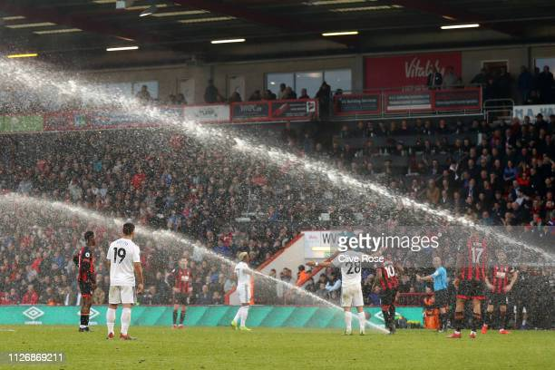 A general view as the sprinklers turn on while play is still going during the Premier League match between AFC Bournemouth and Wolverhampton...