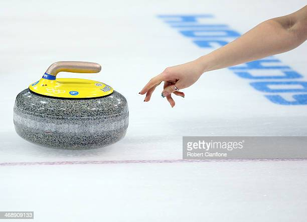 A general view as the stone is released during Curling Women's Round Robin match between Japan and Russia during day five of the Sochi 2014 Winter...