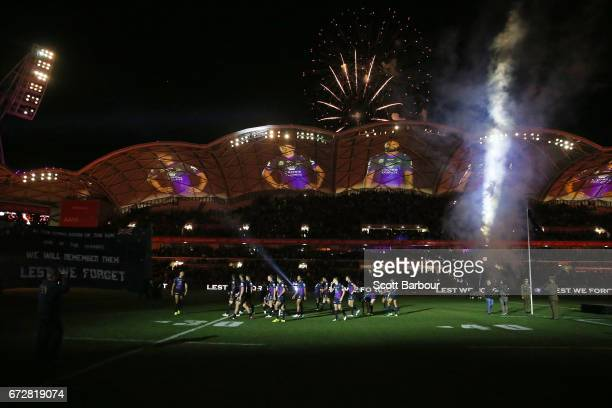 A general view as the Storm stand for the playing of The Last Post during the round eight NRL Anzac Day match between the Melbourne Storm and the New...