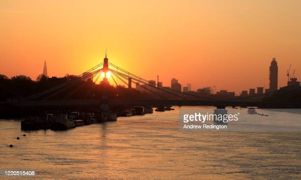 General view as the sun rises over Albert Bridge and the London skyline on April 23, 2020 in London, England. The British government has extended the...
