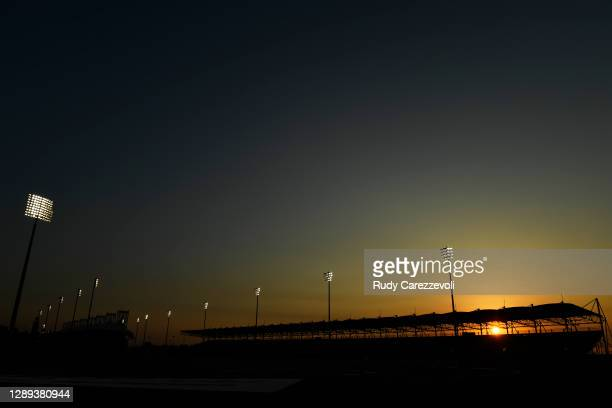 General view as the sun sets behind a grandstand during practice ahead of the F1 Grand Prix of Sakhir at Bahrain International Circuit on December...