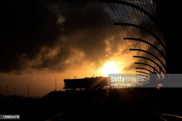 A general view as the sun sets behind the grandstand during a red flag rain delay in the NASCAR Sprint Cup Series Ford 400 at HomesteadMiami Speedway...