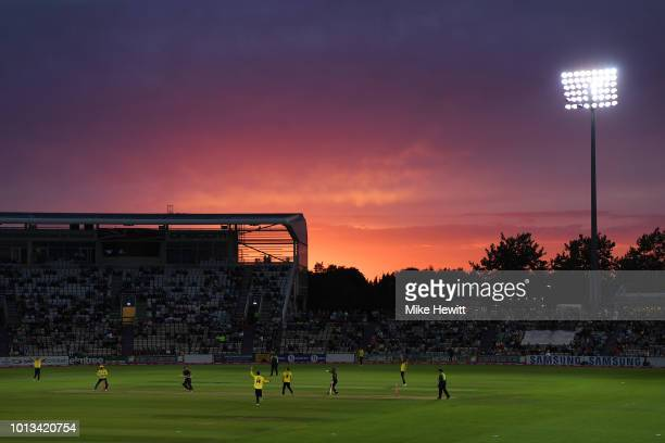 A general view as the Sun sets during the Vitality Blast match between Hampshire and Somerset at The Ageas Bowl on August 8 2018 in Southampton...