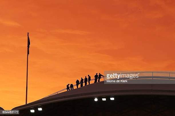 A general view as the sun sets over participants of the Adelaide Oval Bridge Climb experience during day one of the Sheffield Shield match between...