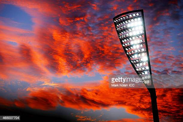 General view as the sun sets over the ground during the 2015 ICC Cricket World Cup match between South Africa and Ireland at Manuka Oval on March 3,...