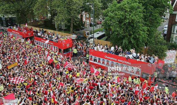 A general view as the team buses arrive at the Islington Town Hall during the Arsenal Football Club victory parade to show the League Champions with...