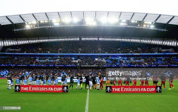 General view as the teams line up to shake hands during the FA Cup Fourth Round match between Manchester City and Fulham at Etihad Stadium on January...
