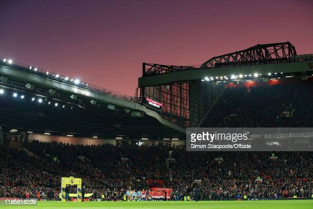 General view as the two teams walk out under a sunset for the Premier League match between Manchester United and Aston Villa at Old Trafford on...