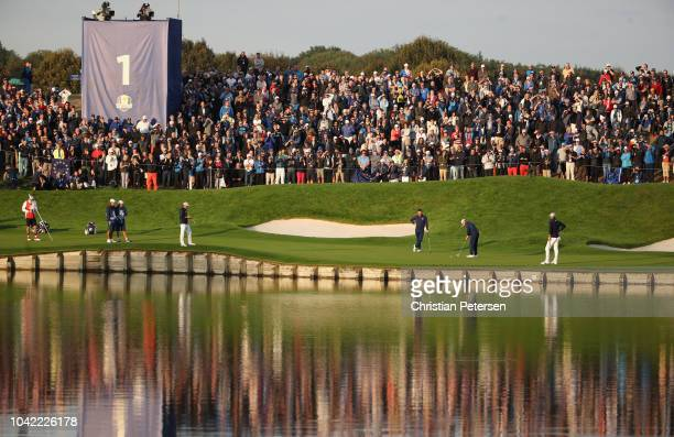 General view as Thorbjorn Olesen of Europe putts on the first during the morning fourball matches of the 2018 Ryder Cup at Le Golf National on...