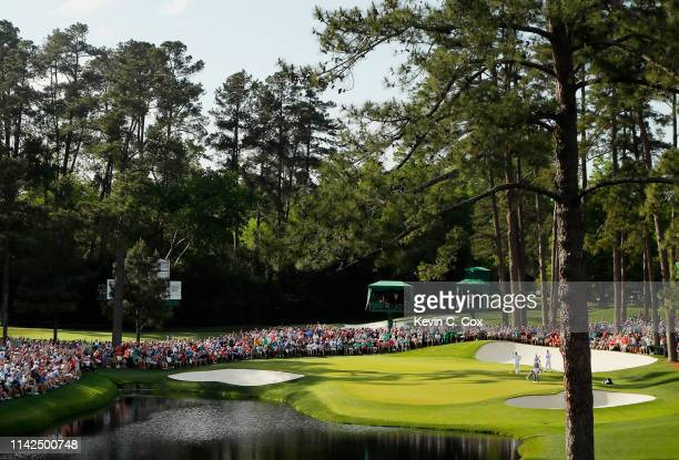General view as Tiger Woods of the United States stands on the 16th green during the third round of the Masters at Augusta National Golf Club on...