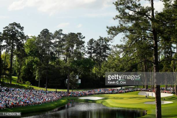 A general view as Tiger Woods of the United States stands on the 16th green during the third round of the Masters at Augusta National Golf Club on...