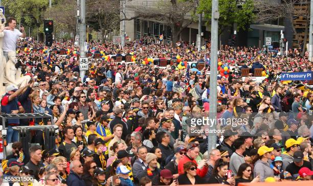 A general view as Tigers and Crows fans in the crowd show their support during the 2017 AFL Grand Final Parade ahead of the Grand Final between the...