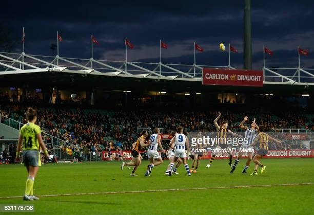 A general view as Tim O'Brien of the Hawks and Braydon Preuss of the Kangaroos compete in a ruck contest during the 2017 AFL round 21 match between...