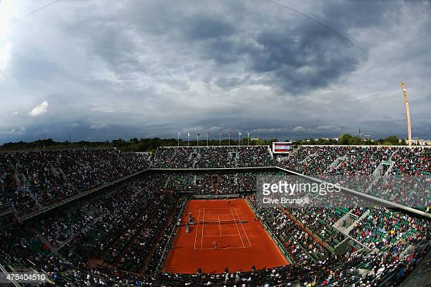 A general view as Tomas Berdych of Czech Republic serves in his Men's Singles match against JoWilfried Tsonga of France on day eight of the 2015...