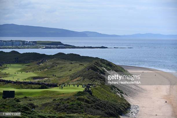 A general view as Tommy Fleetwood of England and Lee Westwood of England play on the fifth green next to the beach during the third round of the...