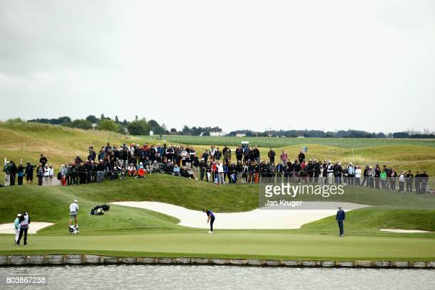 A general view as Tommy Fleetwood of England lines up a putt on the 2nd during day two of the HNA Open de Feance at Le Golf National on June 30 2017...