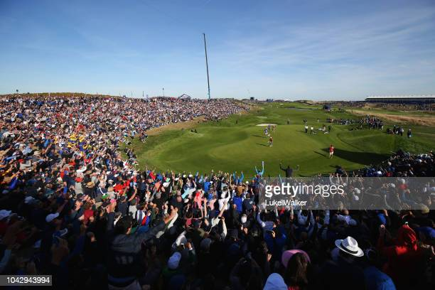 A general view as Tommy Fleetwood of Europe celebrates on the ninth green during the 2018 Ryder Cup at Le Golf National on September 29 2018 in Paris...
