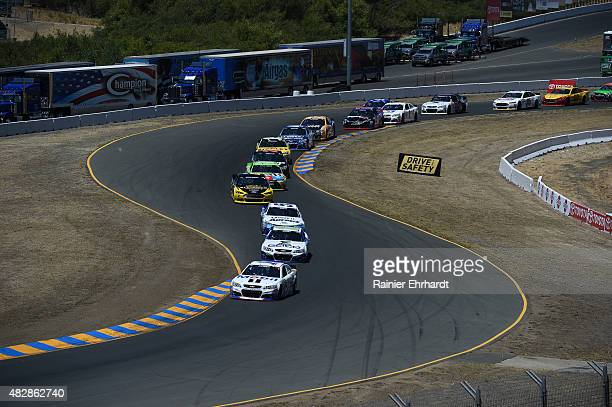 General view as Tony Stewart driver of the Mobil 1/Bass Pro Shops Chevrolet leads a pack of cars during the NASCAR Sprint Cup Series Toyota/Save Mart...