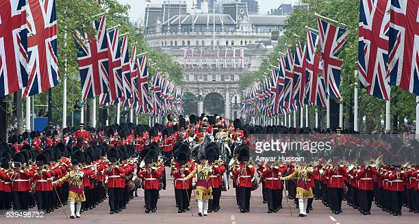 A general view as troops march down the Mall during the Trooping the Colour ceremony to mark the Queen's official 90th Birthday on June 11 2016 in...