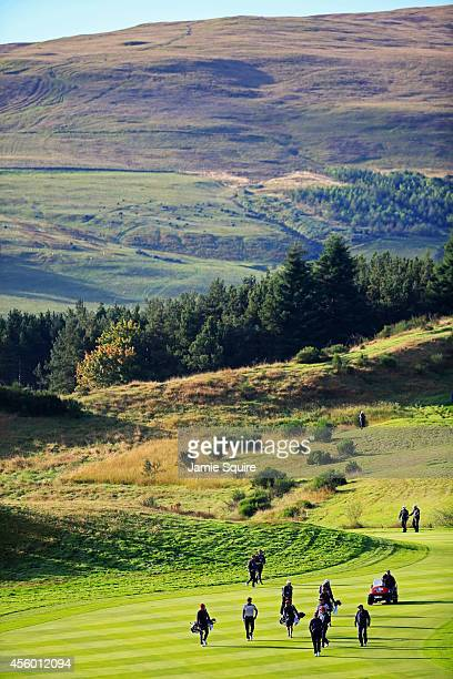 A general view as United States team members walk down the 9th fairway ahead of the 2014 Ryder Cup on the PGA Centenary course at the Gleneagles...