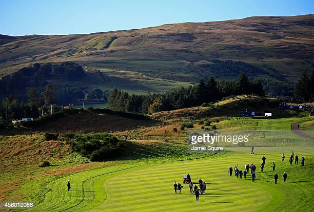 A general view as United States team members walk the course ahead of the 2014 Ryder Cup on the PGA Centenary course at the Gleneagles Hotel on...