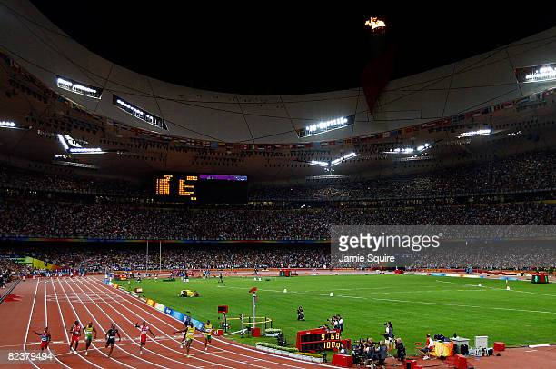 A general view as Usain Bolt of Jamaica crosses the line to win the Men's 100m Final at the National Stadium on Day 8 of the Beijing 2008 Olympic...