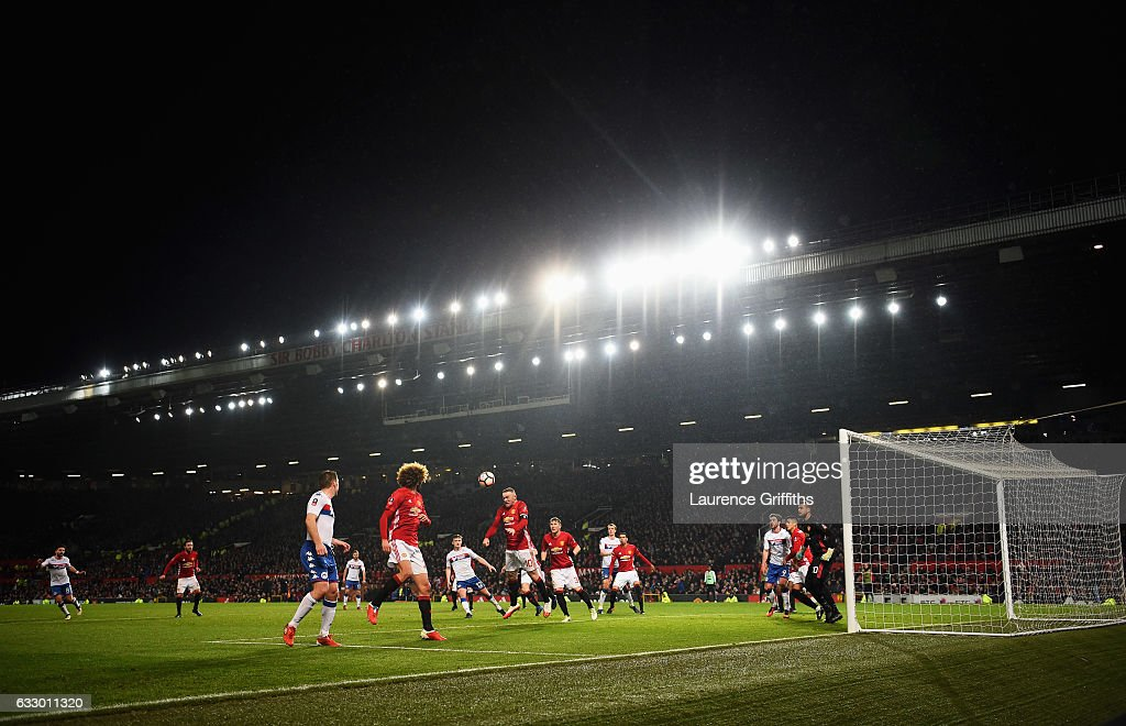 A general view as Wayne Rooney of Manchester United heads the ball during the Emirates FA Cup Fourth round match between Manchester United and Wigan Athletic at Old Trafford on January 29, 2017 in Manchester, England.
