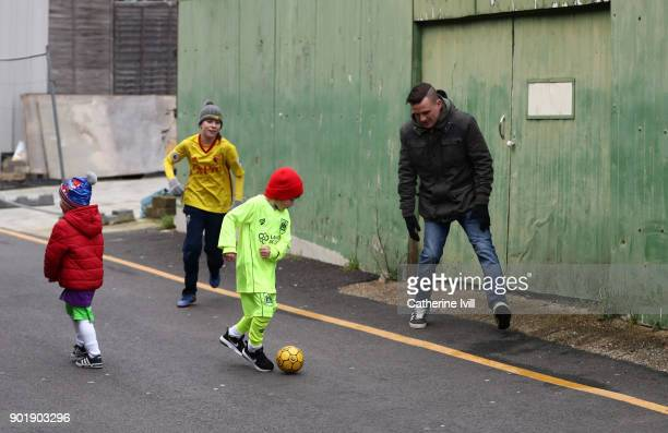 General view as young fans play football outside the stadium before the Emirates FA Cup Third Round match between Watford and Bristol City at...