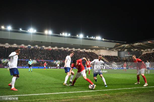 A general view at Kieran Dowell and James Maddison of England battle for the ball with Pawel Tomczyk of Poland during the U21 International Friendly...