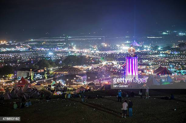 General view at night over the Glastonbury Festival at Worthy Farm Pilton on June 28 2015 in Glastonbury England Now its 45th year the festival is...