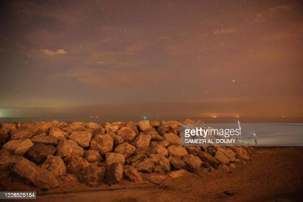 General view at sunset of the beach of Sangatte, northern France, on August 16 where migrants usually attempt to cross illegally the Channel towards...