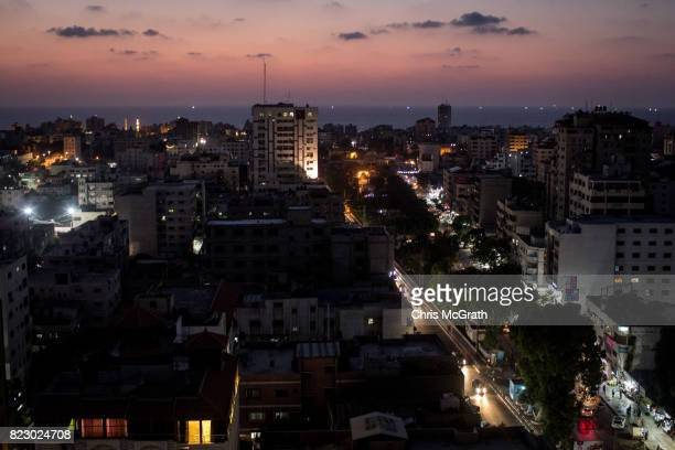 A general view at sunset over Gaza city on July 19 2017 in Gaza City Gaza For the past ten years Gaza residents have lived with constant power...