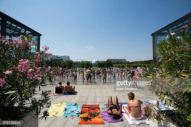 A general view at the fountains on the lawns of the 'Andre Citroen' Park during a hot summer day on July 1 2015 in Paris France France is currently...