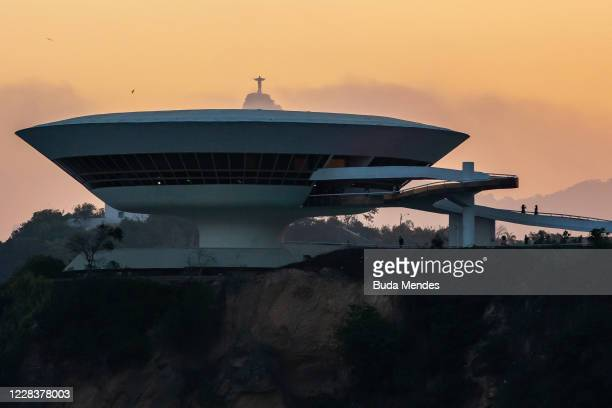 General view at the Museum of Contemporary Art with the statue of Christ the Redeemer at the background on September 6, 2020 in Niteroi, Brazil....