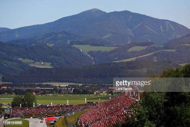 General view at the start as Charles Leclerc of Monaco driving the Scuderia Ferrari SF90 leads the field during the F1 Grand Prix of Austria at Red...