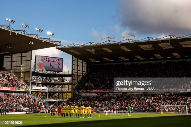 A general view at Turf Moor home stadium of Burnley as both teams pay their respects during the Premier League match between Burnley FC and Chelsea...