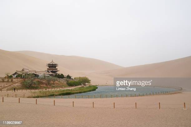 General view Crescent Lake at Mingsha Shan desert on April 23, 2019 in Dunhuang, China. The Mingsha Shan desert is a part of the ancient silk road....
