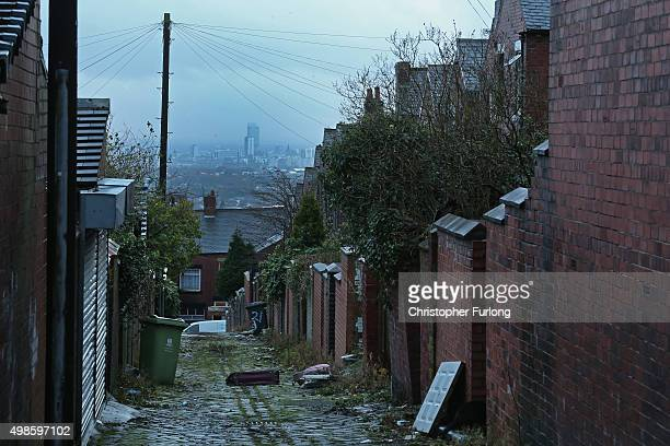 General view down a classic northern back alley with the City of Manchester in the distance as voters prepare to go to the polls in the Oldham West...