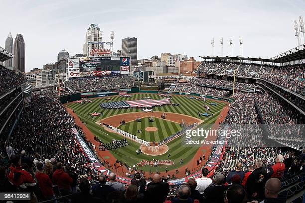 A general view during the singing of the national anthem before the game between the Texas Rangers and the Cleveland Indians during the Opening Day...