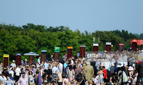 General view fo racegoers and bookmakers at Sandown racecourse on August 31 2013 in Esher England