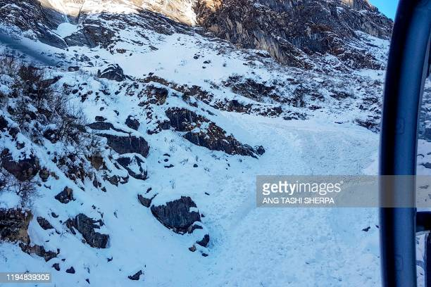 General view from a helicopter of the avalanche site in Annapurna mountain region, some 200 kms west of Kathmandu on January 20, 2020. - Rescuers...